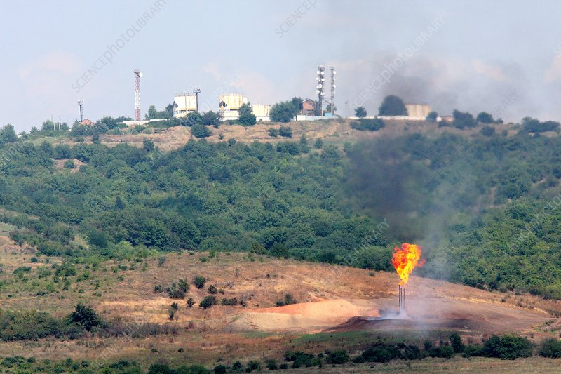 Gas flare and oil storage tanks