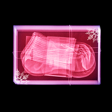 Coloured x-ray of socks in a gift box.