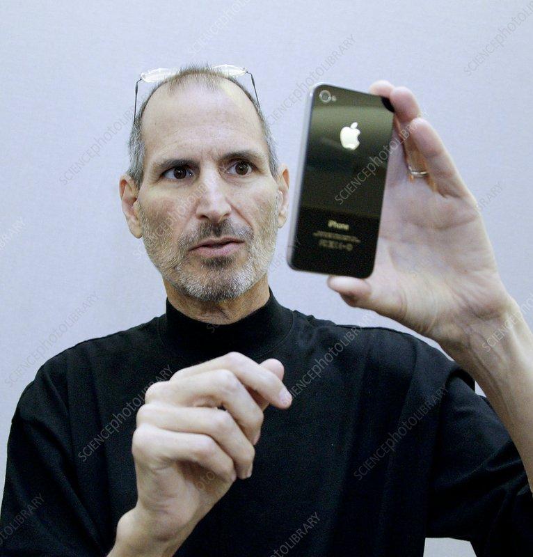 Steve Jobs holding an iPhone 4