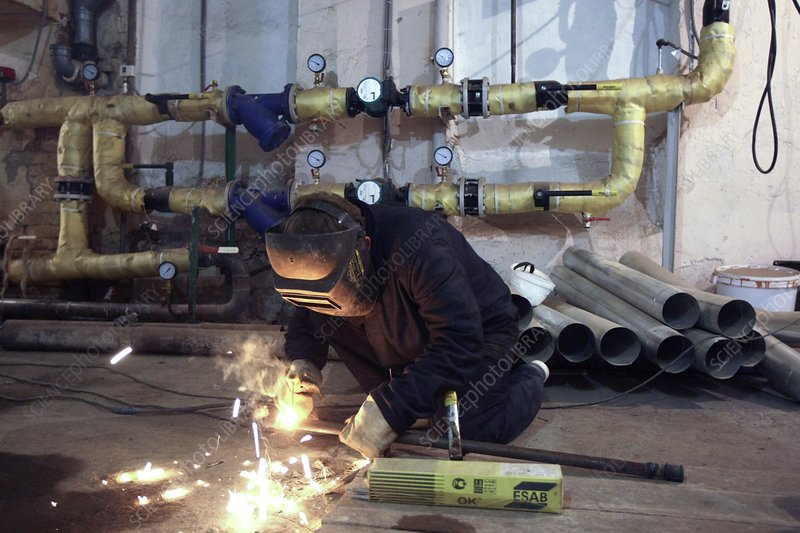 Plumber arc welding pipes