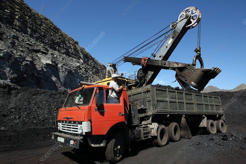 Excavator loading coal at a mine