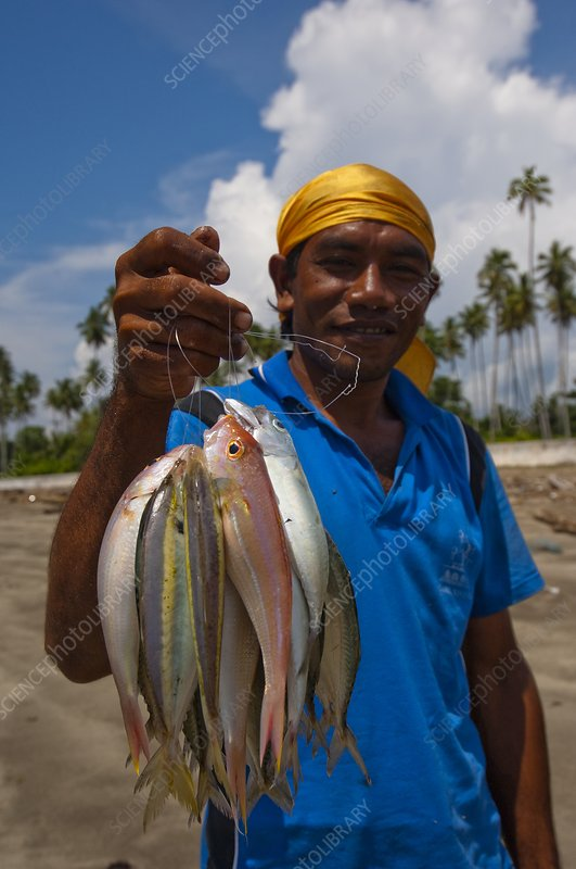 Fisherman with catch in Indonesia
