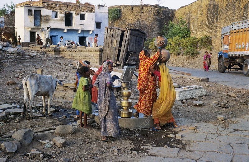 Women collecting water, India