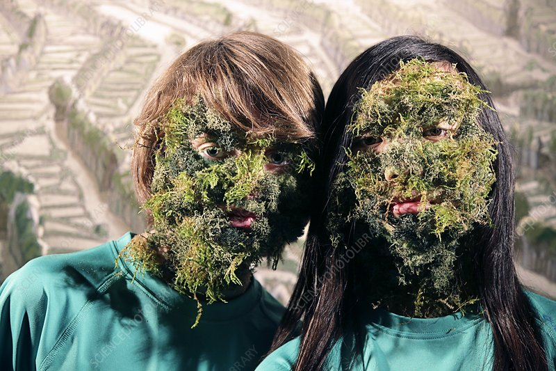 Children's faces covered by plants