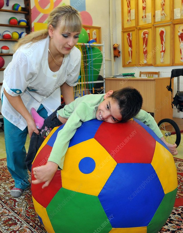 Child undergoing physiotherapy