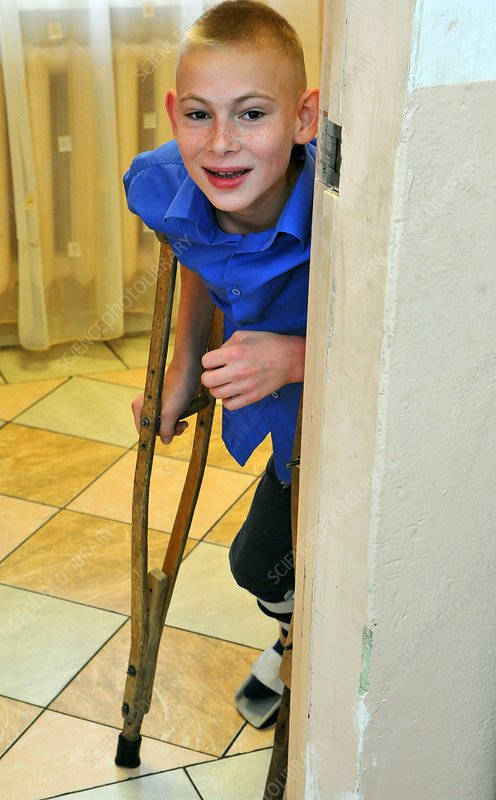 Disabled boy with crutch