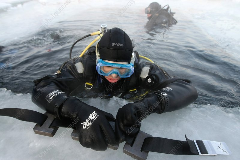 Diver preparing for a dive in icy water