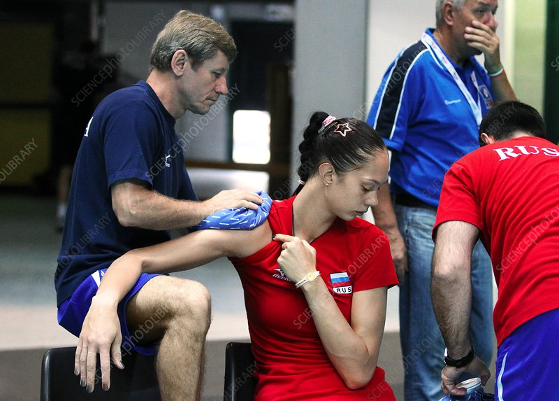 Physio treating volleyball player