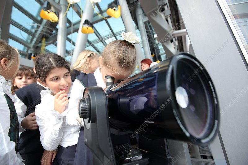 Children using a viewing telescope