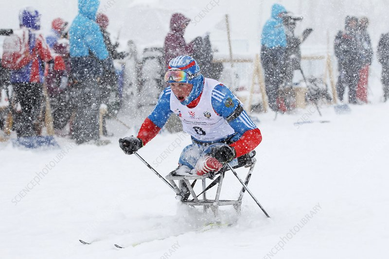 Disabled athlete skiing in biathlon
