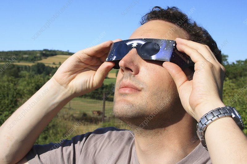 Man observing a solar eclipse