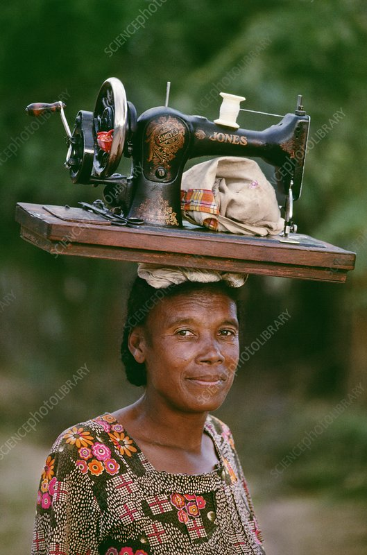 Mahafaly woman carrying sewing machine