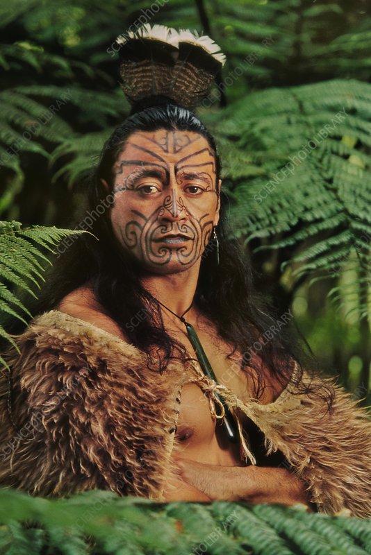 Maori man in kiwi cloak, facial tattoos