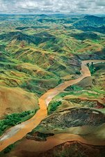 Deforested hills and silt-laden river