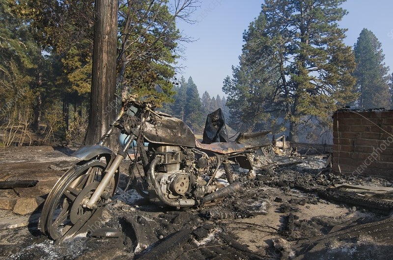 Burned motorcycle remains after wildfire