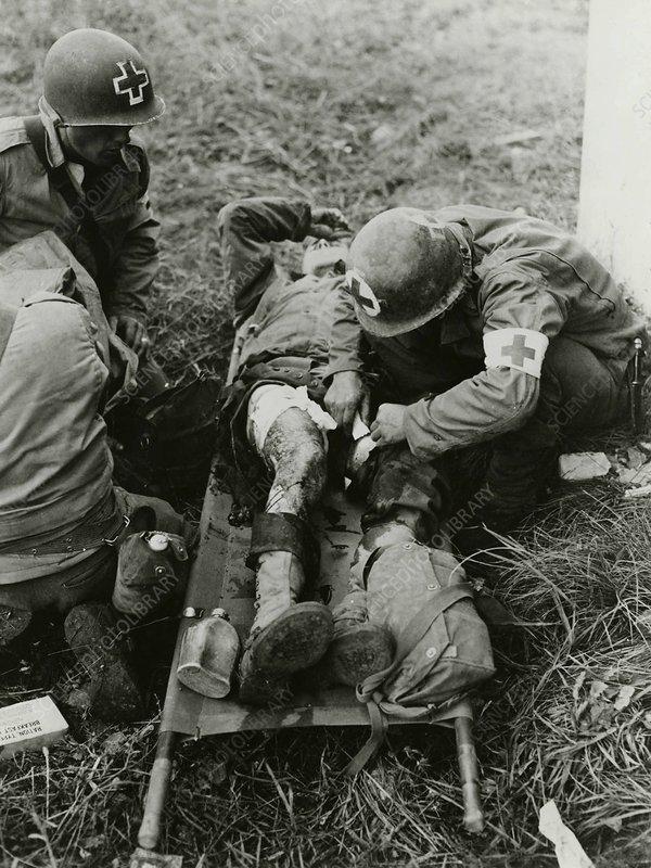 Army medics treating a casualty