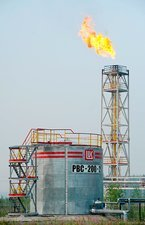Gas flare and oil storage tank