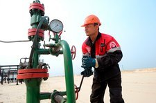 Engineer checking wellhead pressure