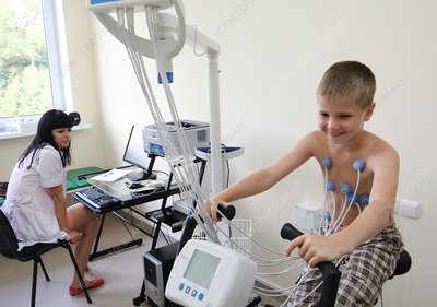 Child having ECG during exercise