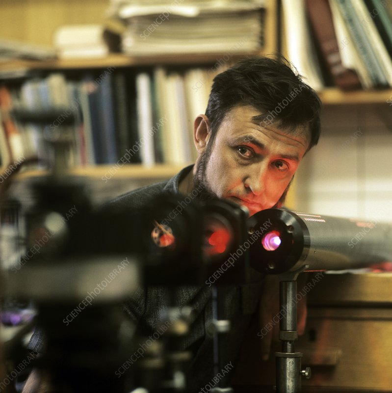 Researcher with a laser, 1971
