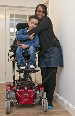 Mother with child with muscular dystrophy