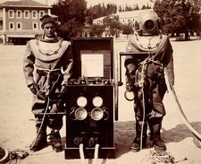 Naval divers in diving suits, 1890s