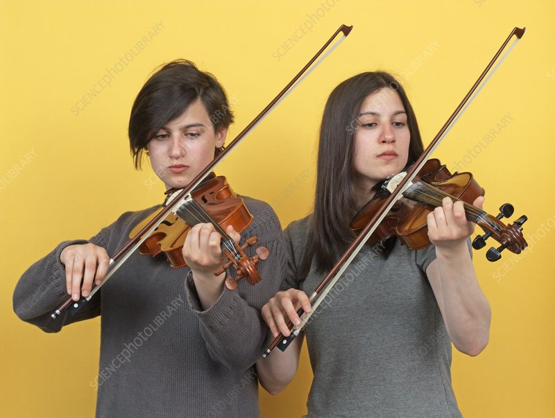 Twins playing violins