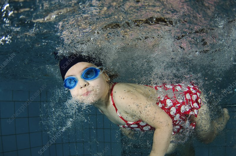 girl swimming underwater