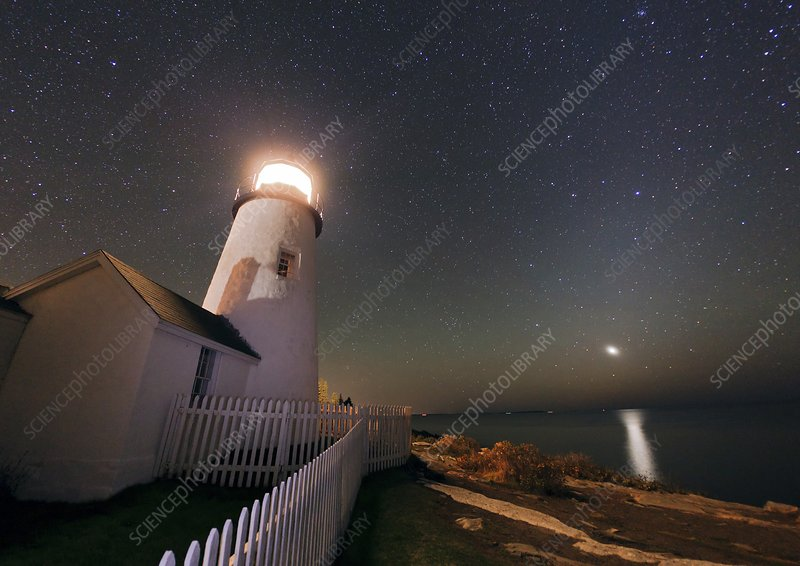 Venus rising by a lighthouse