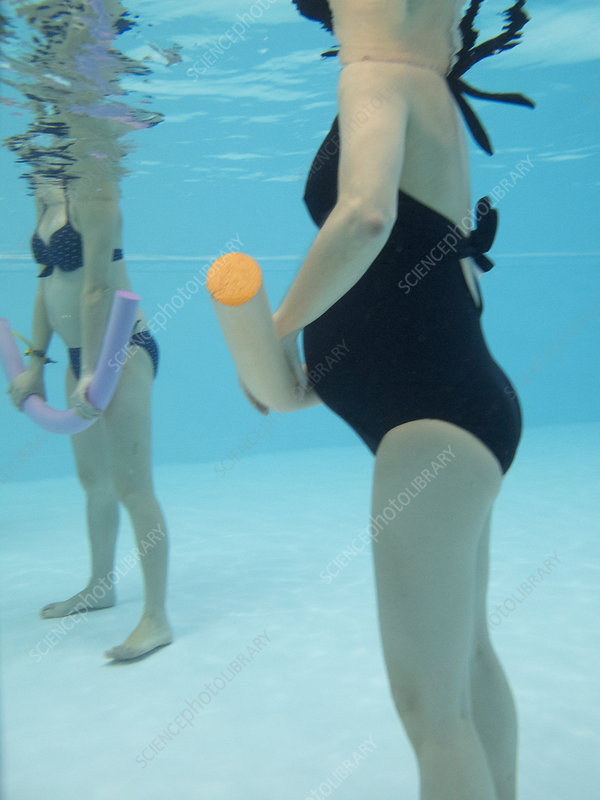 Pregnant woman Exercising In Water