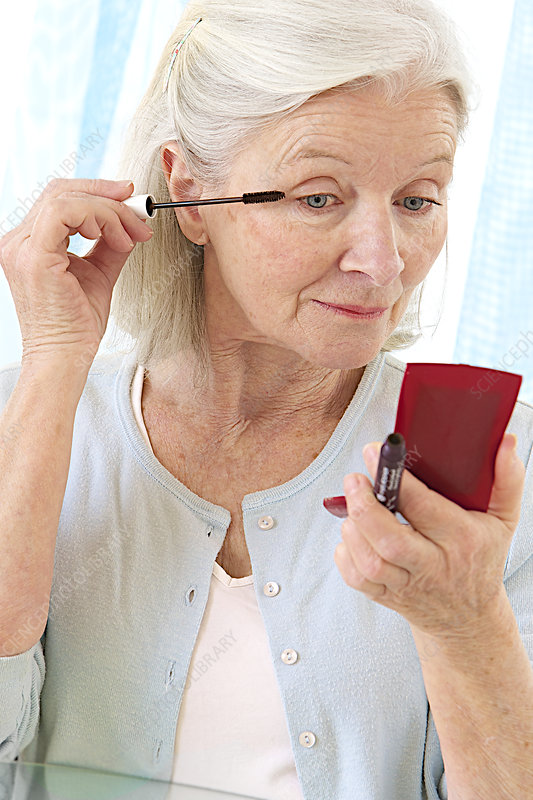 Elderly Woman Putting On Make-Up