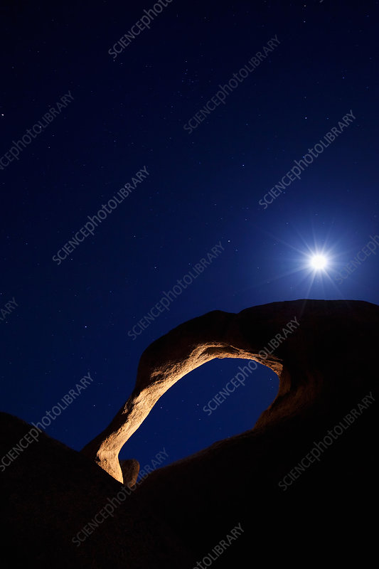 Moonrise over natural arch