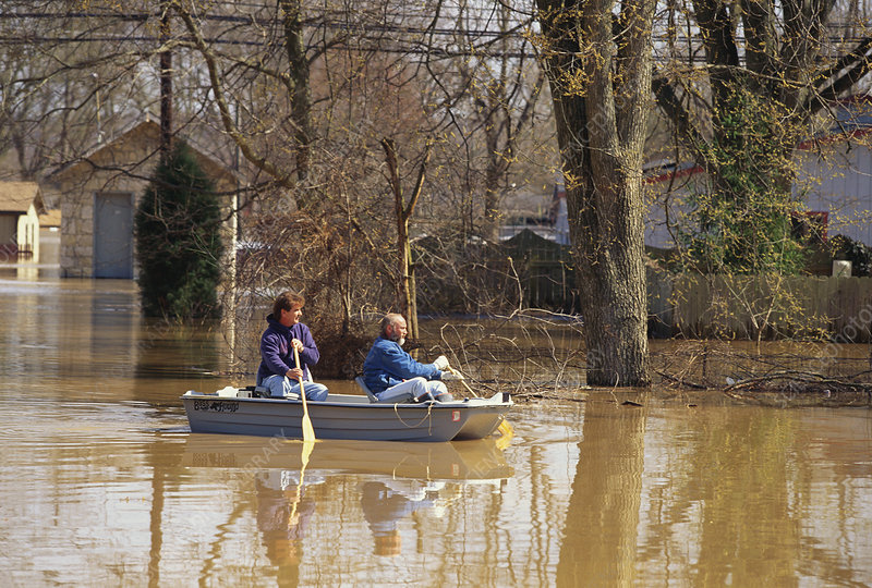 Residents Surveying Damage of Flood