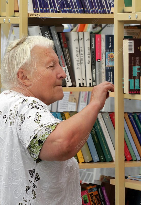 Elderly woman in library