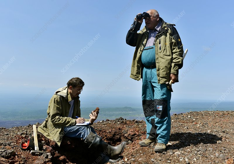 Geologists taking samples near a volcano