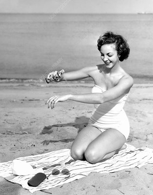 Sun tan oil aerosol use, 1950s
