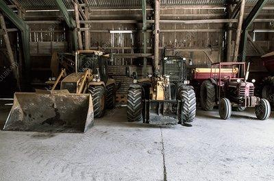 Excavators and a tractor