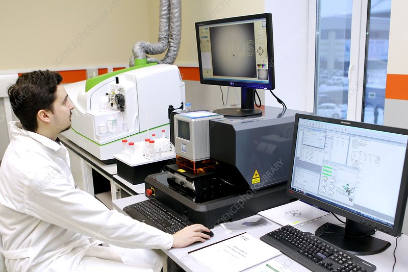 Technician with mass spectrometer
