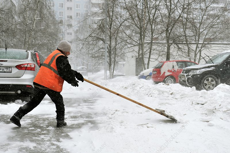 Municipal worker clearing snow