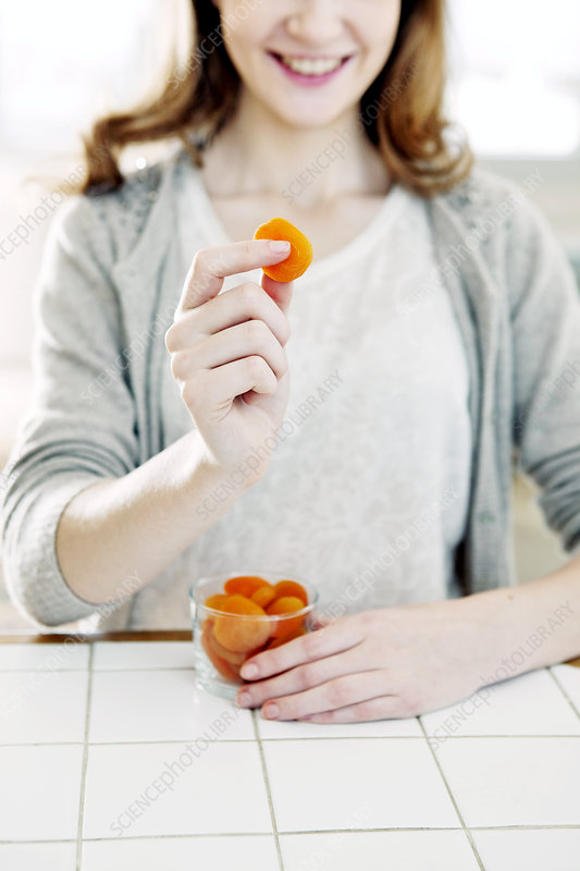 Woman Eating Dried Fruit