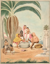 Two women grinding flour