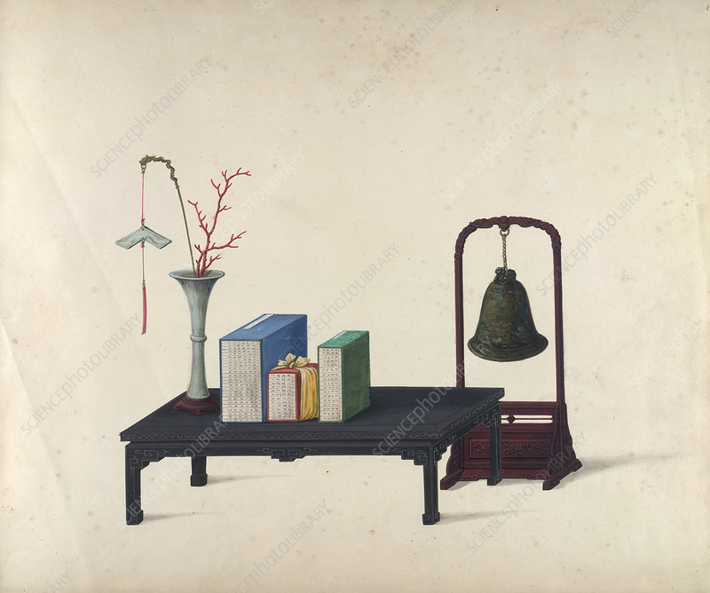A vase, table and bell