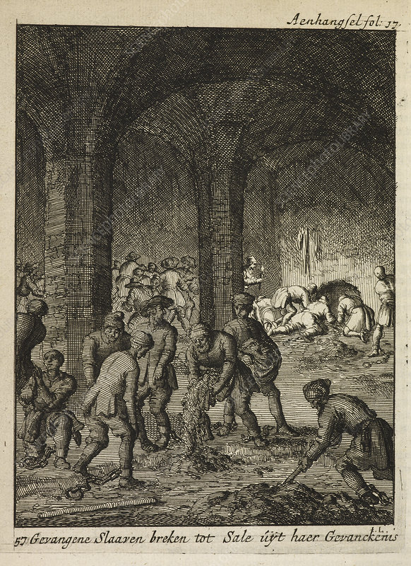 Slaves working in an underground catacomb