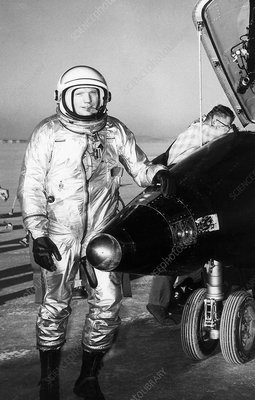 Neil Armstrong next to the X-15 plane