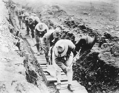 Soldiers fanning gas from a trench, WWI
