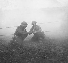 Soldiers repairing telephone wire, WWI