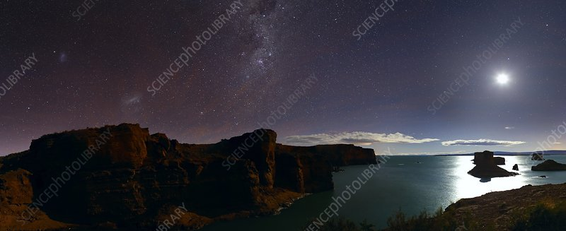 Milky Way and Moon over reservoir