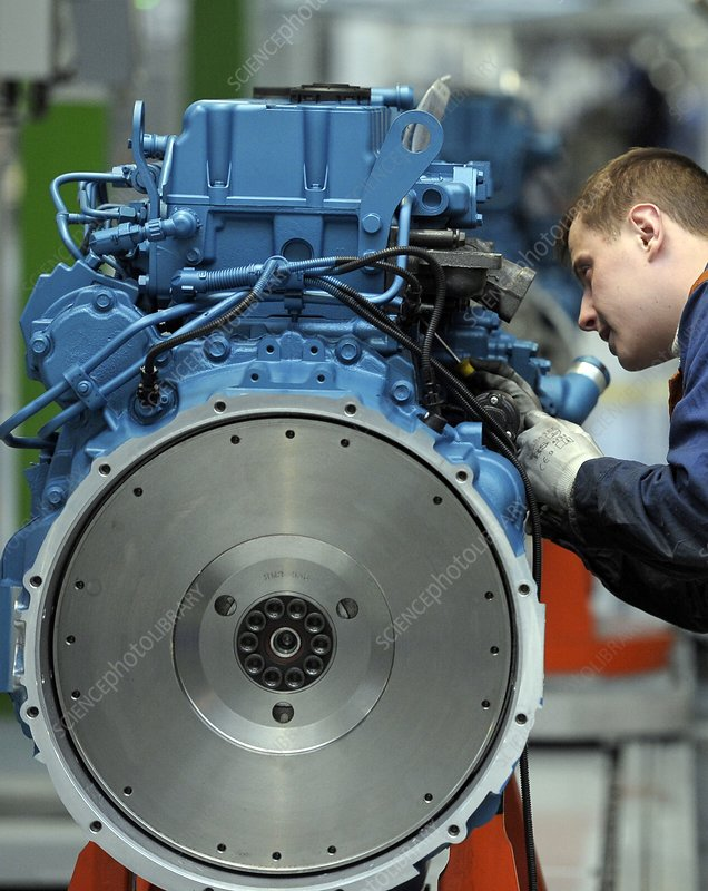 Worker building a diesel engine