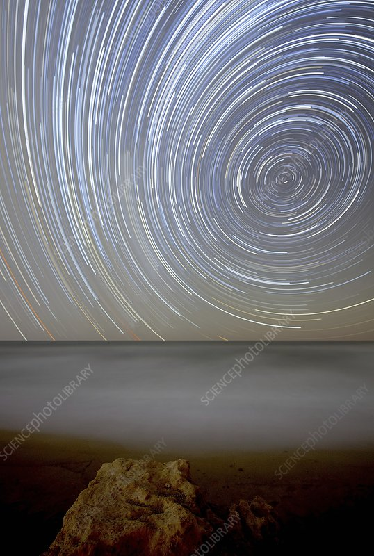 Polar star trails over coastal waters