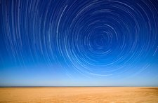 Polar star trails over a beach